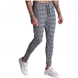 Pantalon à carreaux gris avec bande jaune de la marque gianni kavanagh